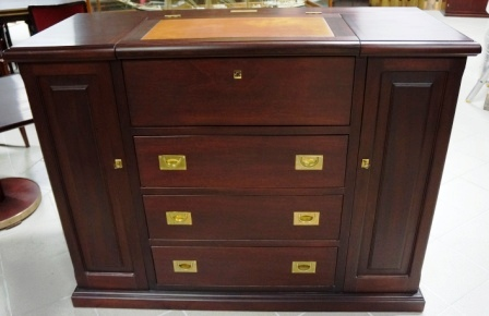 Combined chest of drawers and writing desk/dressing table in mahogany/brass fittings. From the Italian liner M/N G. Verdi.