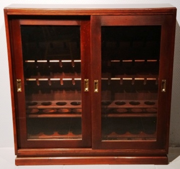 Cabinet with sliding glass doors to store wine and drinking glasses. From the Italian liner M/N G. Verdi. Mahogany/brass, incl 6 storage rails.