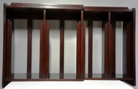 A pair of wall-mounted mahogany racks / stands for plates. 4 compartments/3 different sizes. From M/S Arolla, Nautilus shipping company.