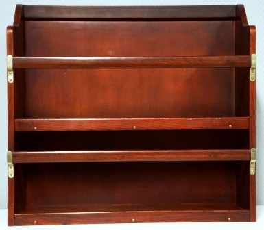Wall-mounted mahogany bookshelf. From the Italian liner M/N G. Verdi. Two compartments, detachable rails.
