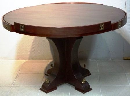 Round table in mahogany with adjustable rails. From M/S Arolla, Nautilus shipping company.