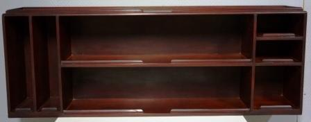 Wall-mounted mahogany shelf from the Italian tanker M/C L. Orlando. Seven compartments.
