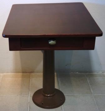 A pair of tables from the Swedish American Liner S/S Kastelholm. One drawer. Mahogany, galvanized brown-painted metal base.