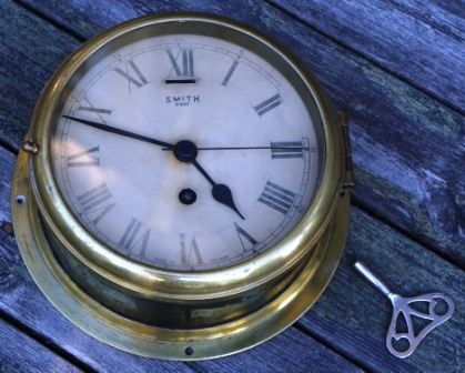 Early 20th century Smith 8 day ships clock made in England. Brass, incl key.