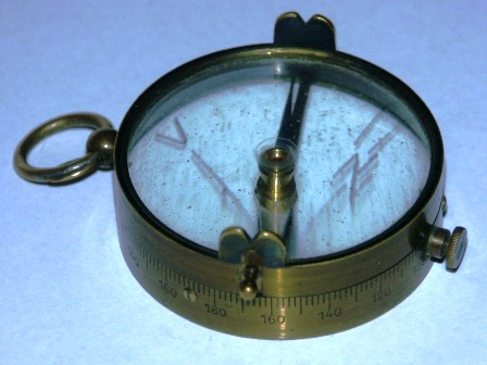 "Early 20th century ""diopter compass"". Brass & glass. Captain L. Lilliehööks Patent, manufactured by Axel Ljungströms Fabrik AB Stockholm. Knob to lock the dial in place."