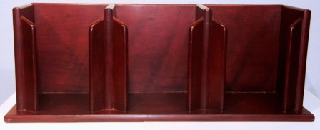 Wall-mounted plate rack / plate stand in mahogany from M/S Arolla, Nautilus shipping company.