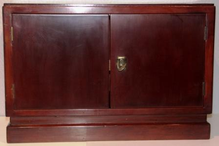 Small cabinet in mahogany from M/S Hohenfels - Hansa Bremen, shipping company Norddeutscher Lloyd (NDL). Double door, one compartment.