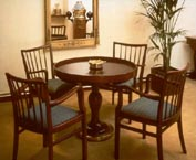 Part of a shipping company guest lounge furnished with restored 20th century original ship's table, armchairs, original binnacle and various navigational instruments.