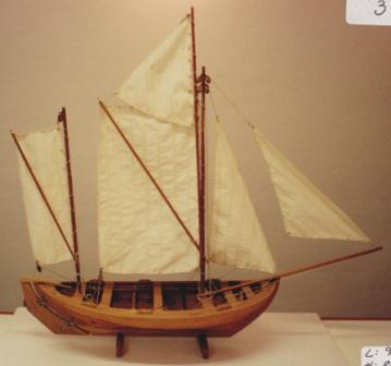 20th century clinker-built and copper-riveted wooden sailing boat with spritsails.