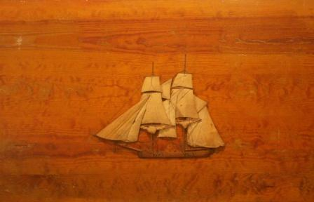 The sailing ship Integrity. 19th Century Silk and Wood Picture mounted on wooden panel.