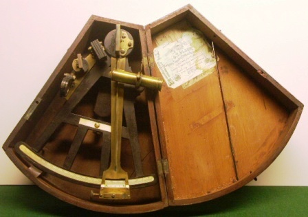19th century octant in original mahagony case. Maker unknown. Adjusted by O.T.Olsen compass adjuster and nautical instrument maker in Grimsby, ebony frame, scales and maker`s plaque in ivory, one telescope and one sun-filter.