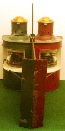 An unusual pair of early 20th century navigation lamps made in a single unit housing both the port and starboard oil-burning lamps in one and the same case. Red and green painted case with detachable light-separating unit. Marked with three crowns St 18772.