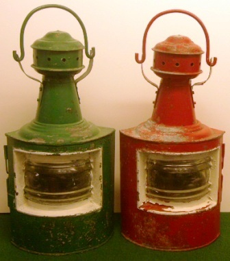 A pair of early 20th century navigation lamps with oil-burning lamps missing, red and green painted galvanized port and starboard case.