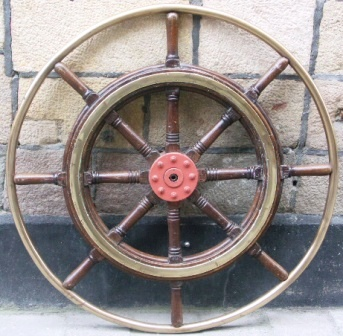 Early 20th century eight-spoked teak ships wheel with double brass bands and brass frame