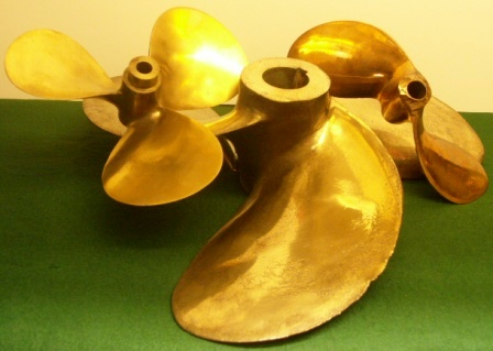20th century two, three and four-bladed propellers in solid brass.