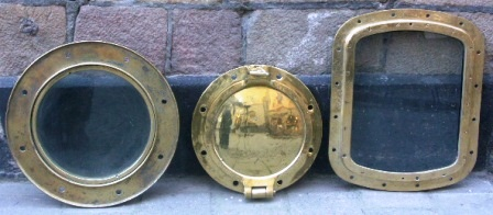 "20th century rectangular and round brass portholes with and without ""storm-lid""."