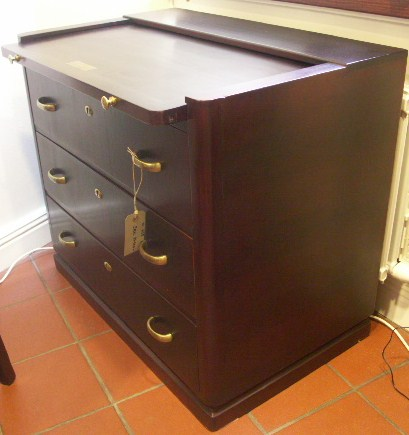 Chest of three drawers and with a sliding leaf. Mahogany and brass from the Italian liner M/N G. Verdi.
