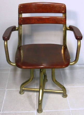 Armchair in mahogany and brass from American Seating Company. 1950's.