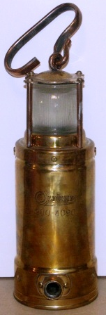 1930's/1940's battery driven emergency light. Made by Oldham England, No 900-4090. Brass, detachable handle.
