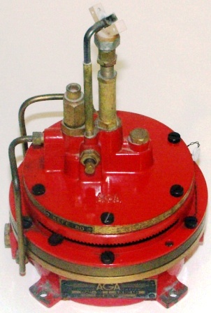 20th century gas-fired beacon ignition apparatus made by AGA Gasaccumulator Stockholm, System Dalén. Made of red-painted brass.