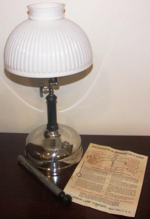 "Early 20th century chrome-plated ""Diamond"" kerosene lamp with ribbed glass-shade. Made by Akron Lamp Company, Ohio U.S.A. Incl operating instructions and original accessories."