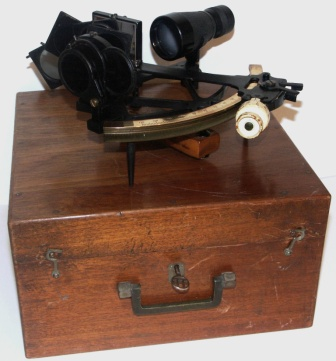 20th century brass sextant. Made by W. Ludolph, Bremerhaven. One adjustable telescope and seven sun-filters. In original mahogany case.