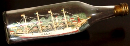 Early 20th century sailor-made ship model housed in bottle depicting the 4-masted Swedish barque ARRAC