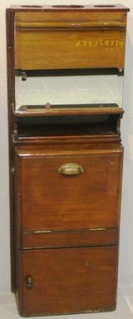 Mahogany wash cabinet for wall mounting with porcelain basin and brass tap. Made by A & R Smith Glasgow. Incl mirror, shelf as well as holder for glasses and decanter. Water container and portable wastewater bucket missing.