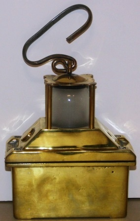 Mid 20th century battery driven emergency light. Brass, detachable handle.