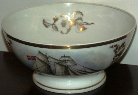 19th century Captains' bowl made in porcelain and used for presentation to captains sailing through the Sound of Elsinore, Denmark. Decorated with a finely painted Danish two-mast sailing vessel. Signed with initials and dated November 14, 1859.