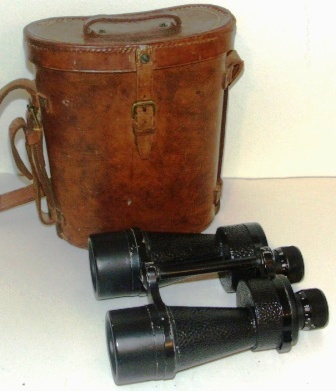 "WWII ""RL - Timbers"" Binocular Prismatic No 5. MK I, x7. Made 1940 of black laquered metal, leather-bound. In original leather case."