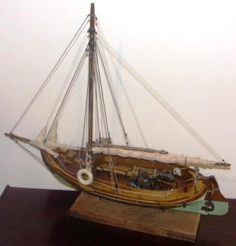 20th century clinker-built and gaff sail-rigged open coaster type model equipped with compression-ignition engine.