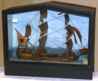Early 20th century built diorama depicting a Mediterranean sailing vessel in full sails.