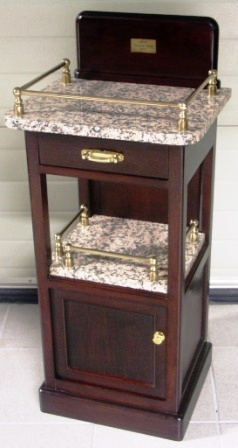 Bedside cabinet in darkstained oak from the British liner M/S Capetown Castle 1937. Drawer and compartment. Furnished with granite top and brass rails.