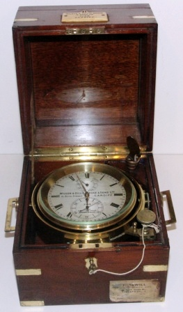 19th century two days marine chronometer No 7149. Made by Wilson & Gillie Bruce & Sons Ltd, 91 Bute Street, Cardiff and at Dock View Road Barry Dock. Mounted in brass gimbals, mahogany case and brass fittings.