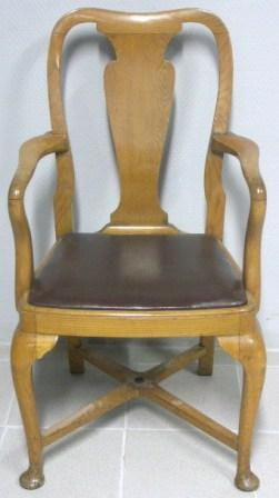 Numbered armchair in golden oak. Leather seat. Early 20th century.