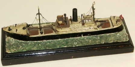 20th century metal built model / cigarette lighter, mounted on wooden base. Depicting the British freighter Alice-London.