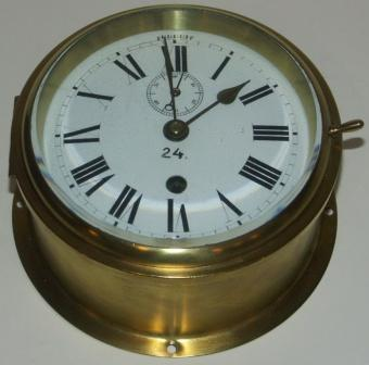 Early 20th century ships clock from an English Naval vessel. Made of brass.