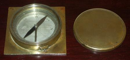 Early 20th century brass compass with lid.
