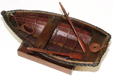 20th century clinker-built wooden dinghy, mounted on wooden base