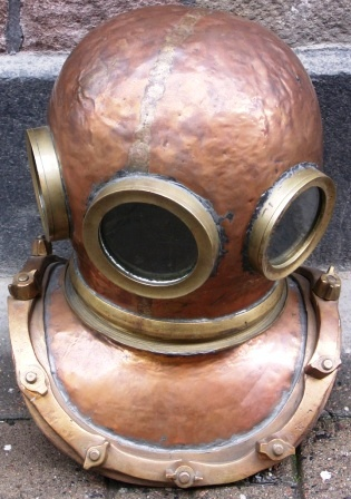 Early 20th century 12 bolt/three-light copper diving helmet. Manufacturer unknown.