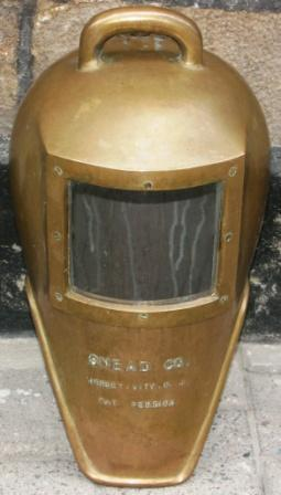 Early 20th century U.S. shallow water brass diving helmet. Made by Snead Co., Jersey – City N.J.