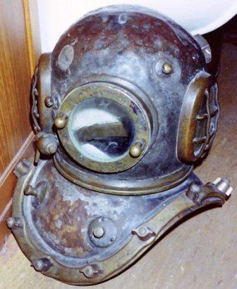 Early 20th century copper diving helmet. Manufacturer unknown.