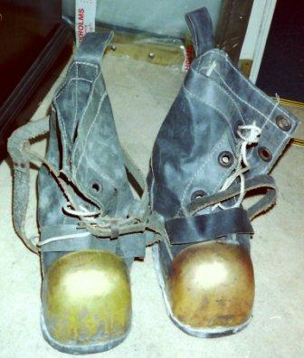 A pair of 20th century Russian diving shoes (Soviet Union). Lead soles, canvas and brass shod.