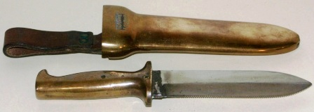 20th century diving knife made by C.E. Heinke & Co. Ltd, London. In brass with double edged blade.