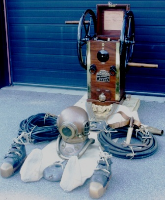 "Early 20th century complete professional diving gear made by Siebe Gorman & Co Submarine Engineers London containing; single cylinder double-acting air supply hand-pump, 6-bolt copper helmet and corselet with matching number 14616, matching twill suit, front and back lead weights, knife with wooden handle and brass sheat mounted on leather belt, lead boots with brass toe caps and laces, jock strap with brass hangers, air line 50ft., corselet ""T"" spanner and air line spanner as well as telephone cable 200ft. with sealing caps."