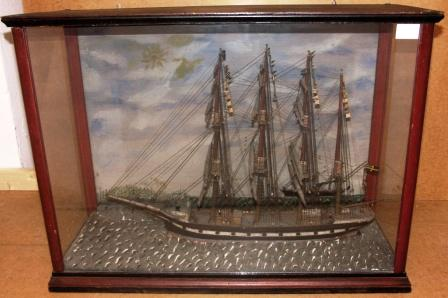 19th century sailor-made model depicting the Swedish 4-masted barque EJGENIA, flying the Union Flag. Painted background depicting coastal scenery and French steamer COLUMBIA.