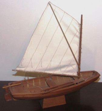 Mid 20th century clinker-built wooden skiff with spritsail