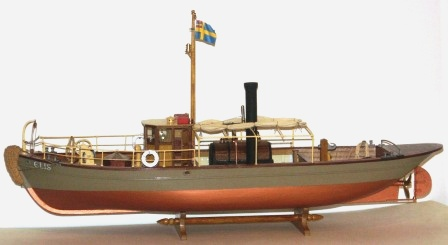 20th century built steam-powered wooden tug-boat ELIS. Complete with individually built and functional steam engine.