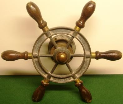 20th century six-spoked galvanized steering wheel with handles in mahogany and brass.